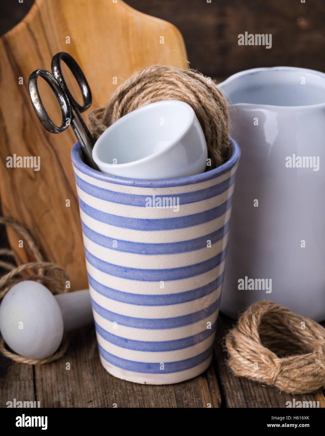 Beautiful stripped mug on wooden background - Stock Image