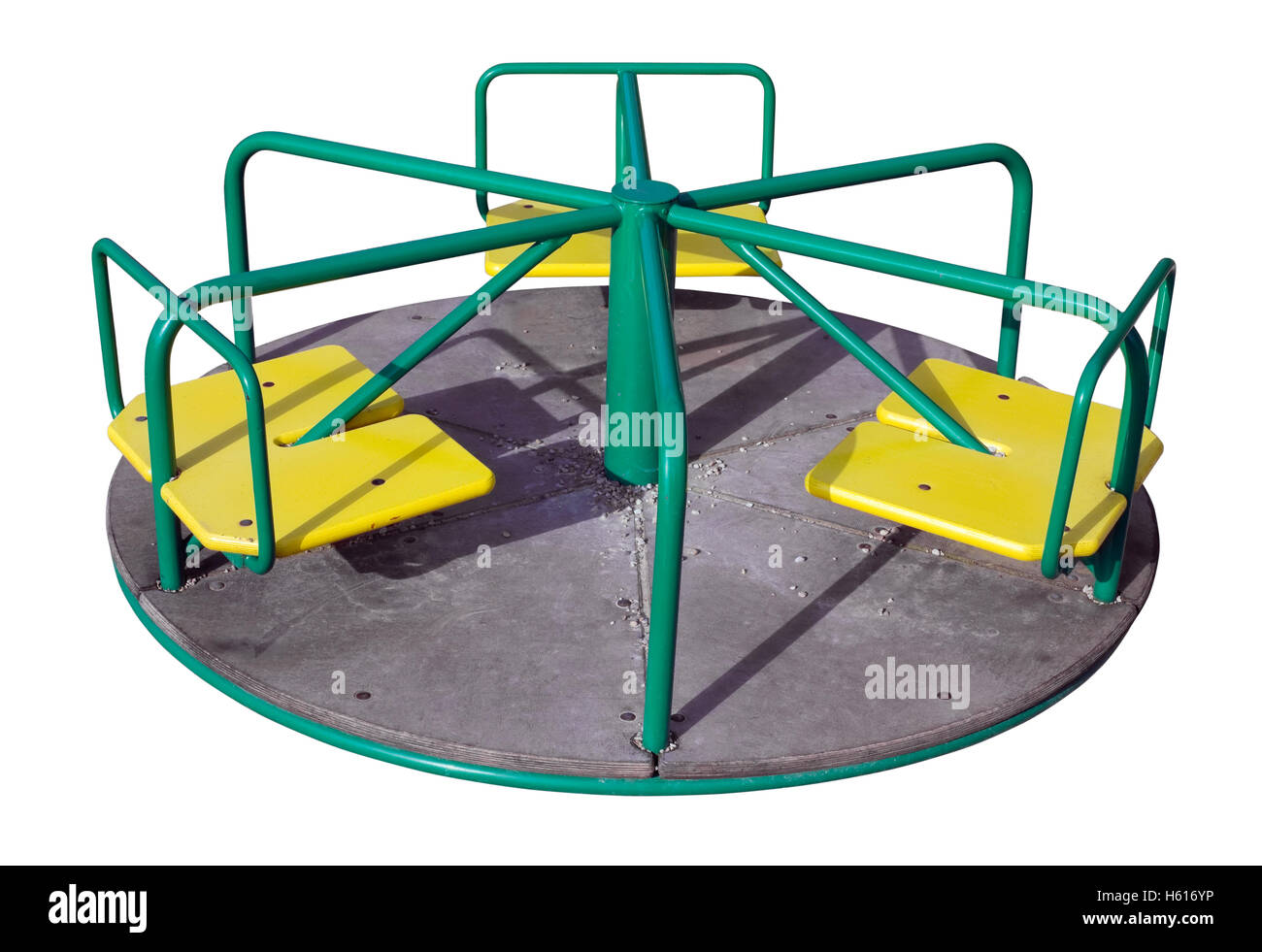 Small  simple mechanical roundabout  carousel on the children's playground. Isolated with patch - Stock Image