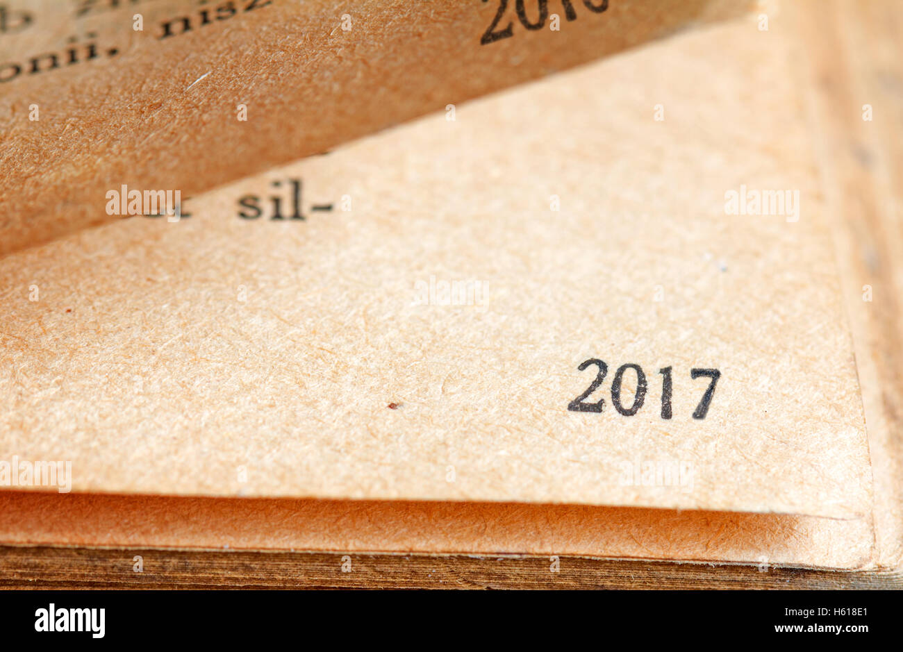 2017 new year numbers on the page of book background unique concept