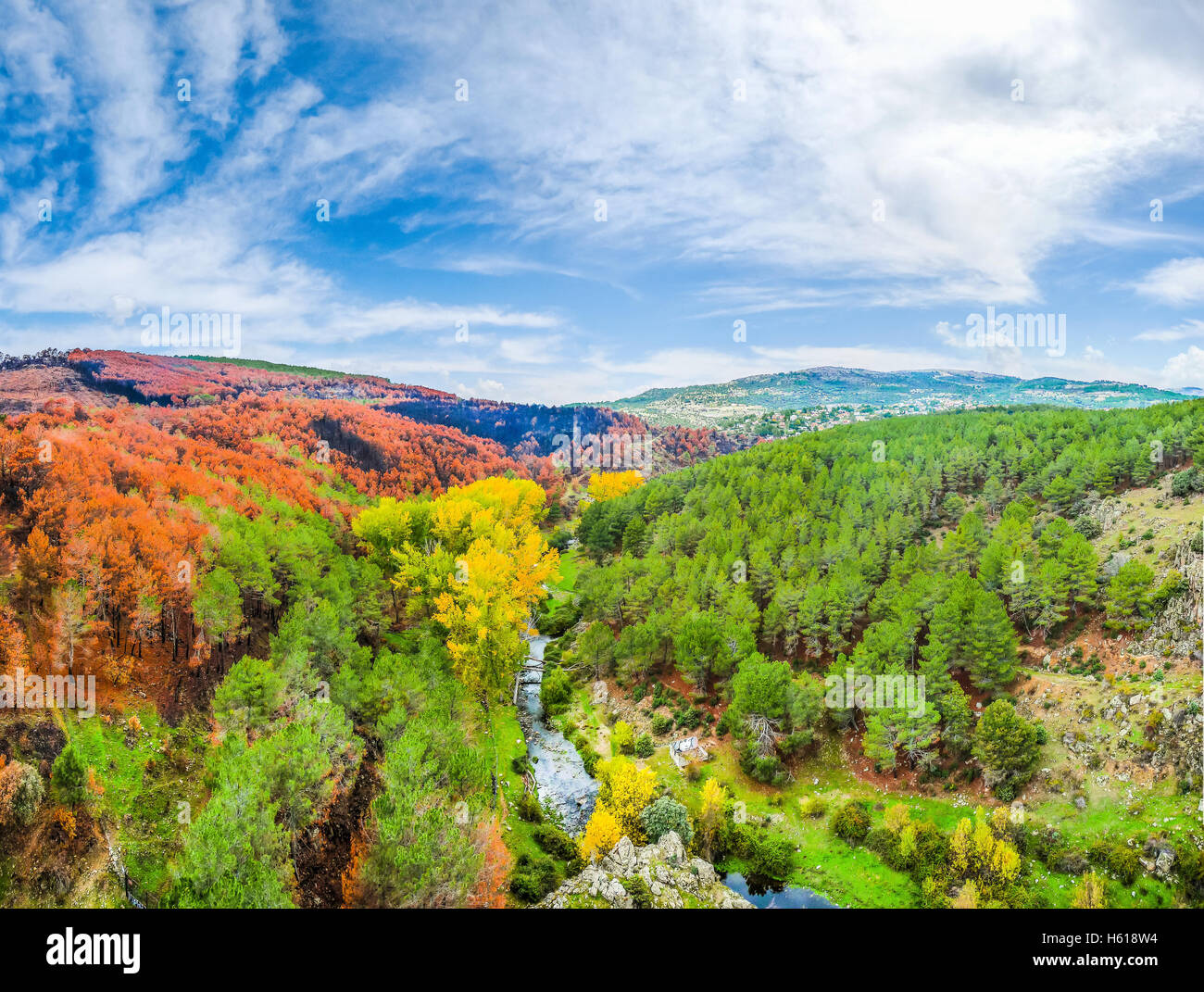 Beautiful autumn landscape with colorful forests and blue sky near Madrid in the autonomous community of Castilla Stock Photo