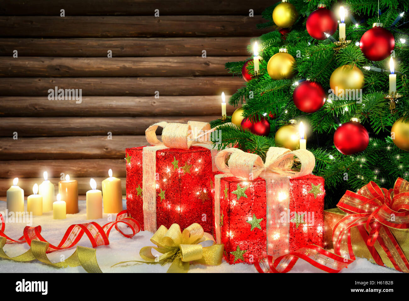 Shiny Christmas Scene With A Tree Candles Ornamental Gift Boxes Lamps