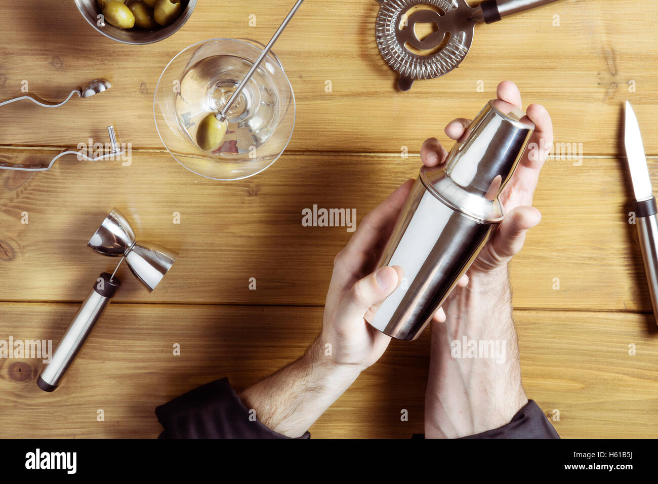 overhead of barman at work - Stock Image