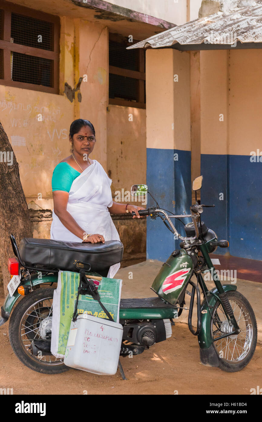 Nurse and her motorbike serving rural communities. - Stock Image