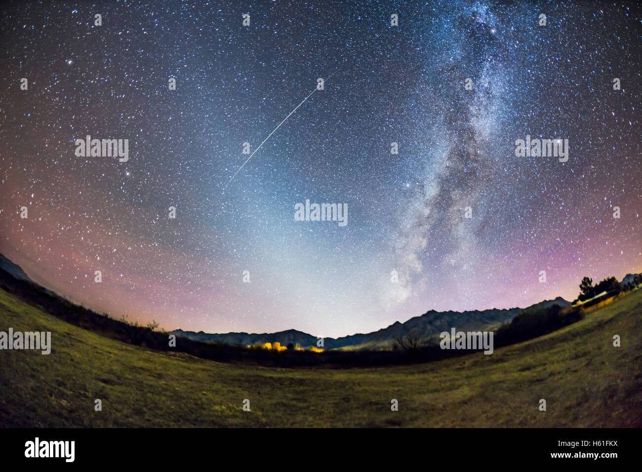 The Zodiacal Light in the the late autumn evening sky from Arizona, overlooking the Chiricahua Mountains near Portal, Stock Photo