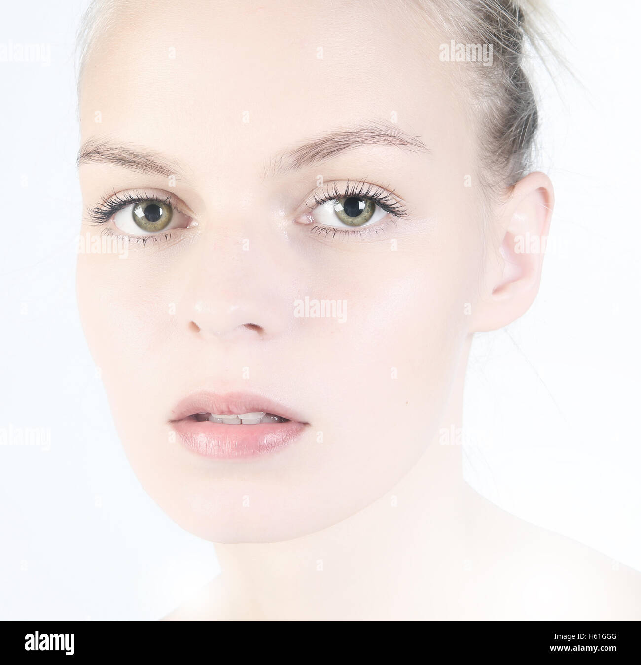 Woman beauty face portrait isolated on white with healthy skin - Stock Image