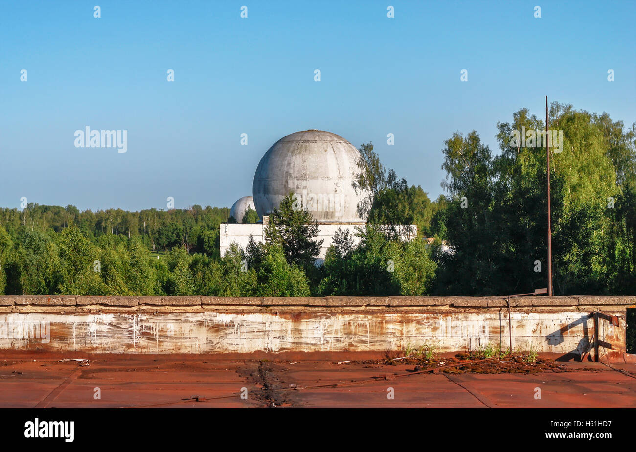 Old big dome of a radar antenna of a Russian military base - Stock Image