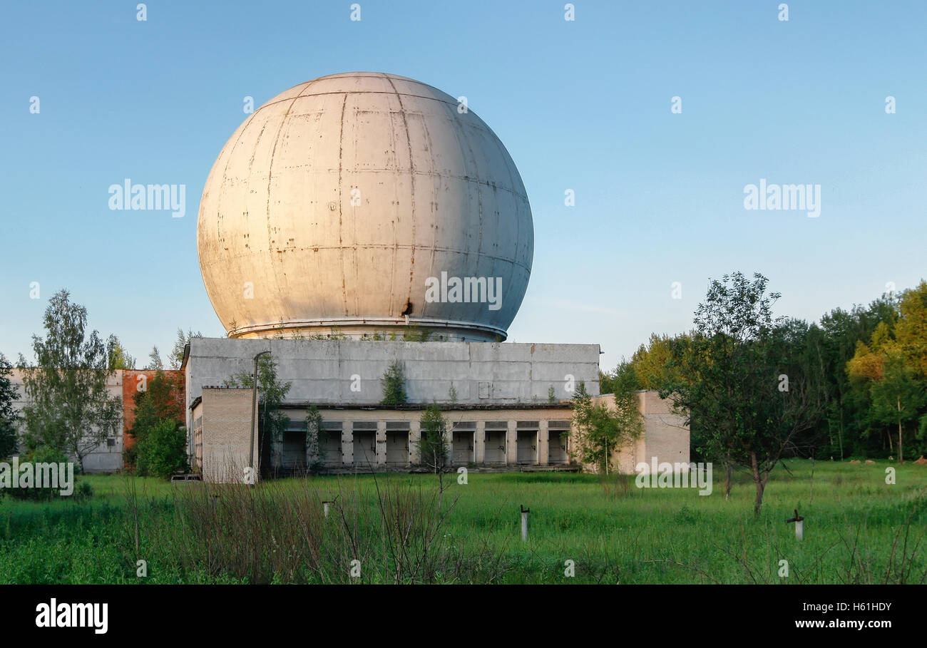 Old giant dome of a radar antenna of a Russian military base - Stock Image