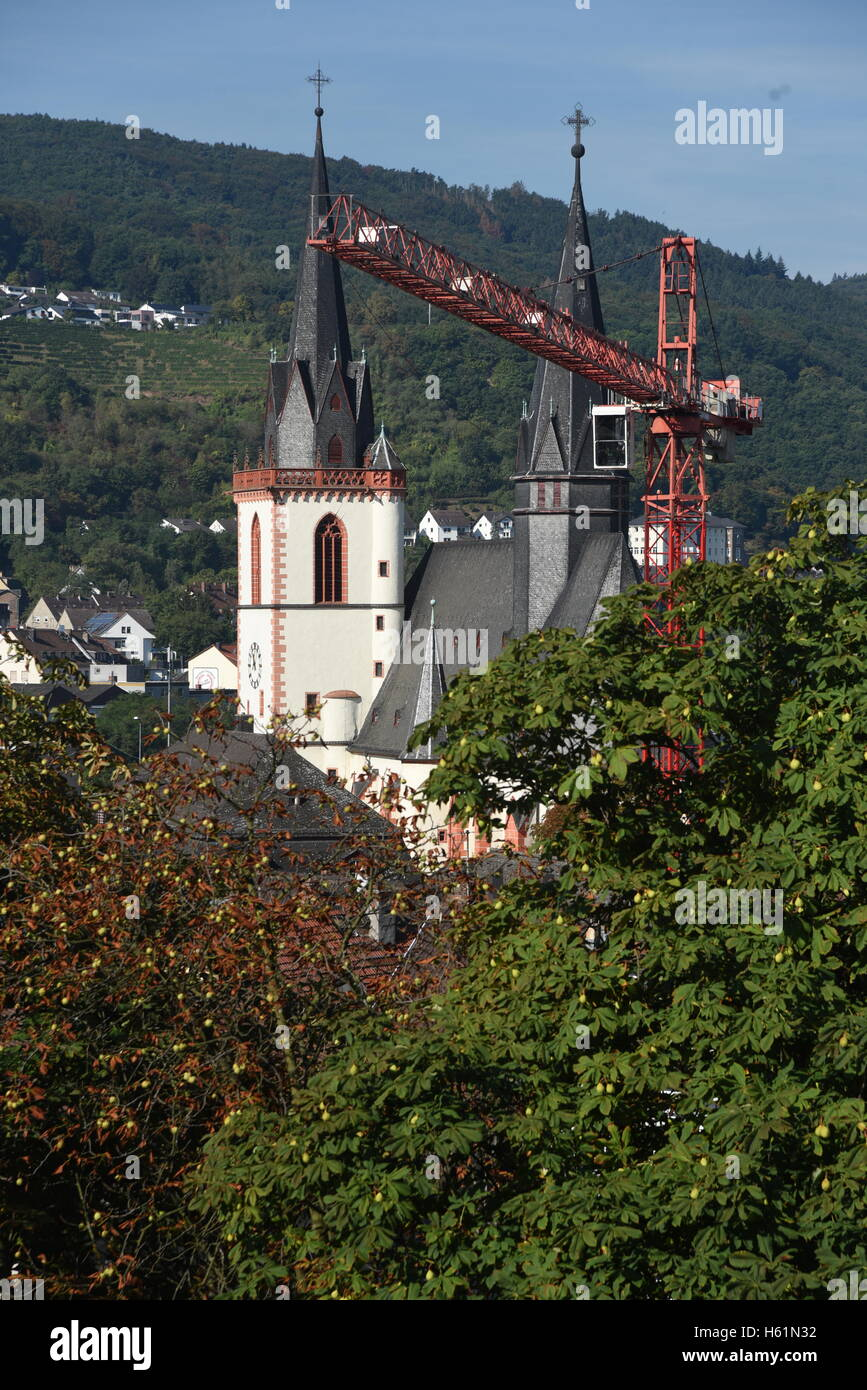 Bingen am Rhein, Germany, construction crane in front of the church - Stock Image