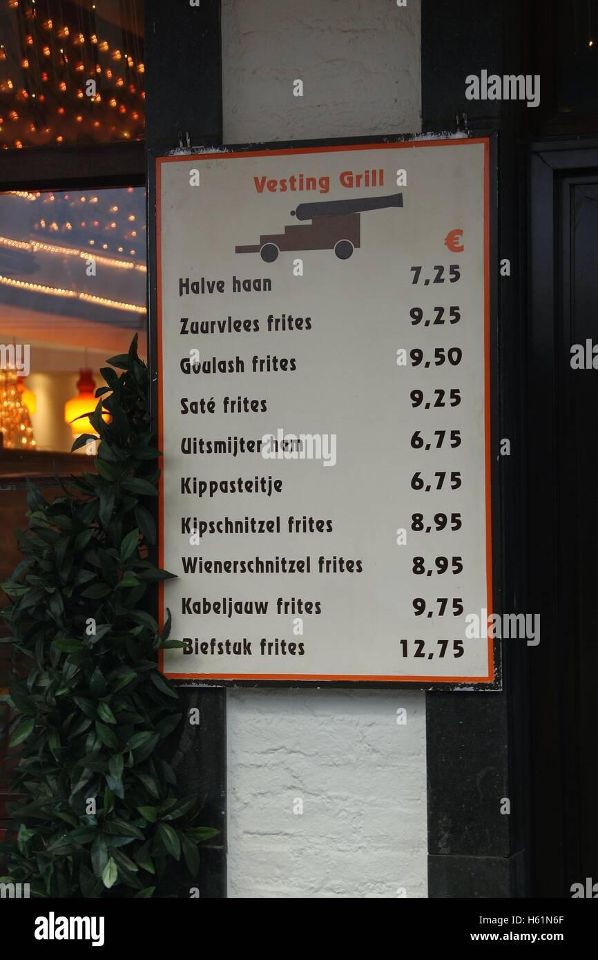 A food advertising menu board outside De Vesting Grill cafe on Muntstraat in the market city of Valkenburg South - Stock Image