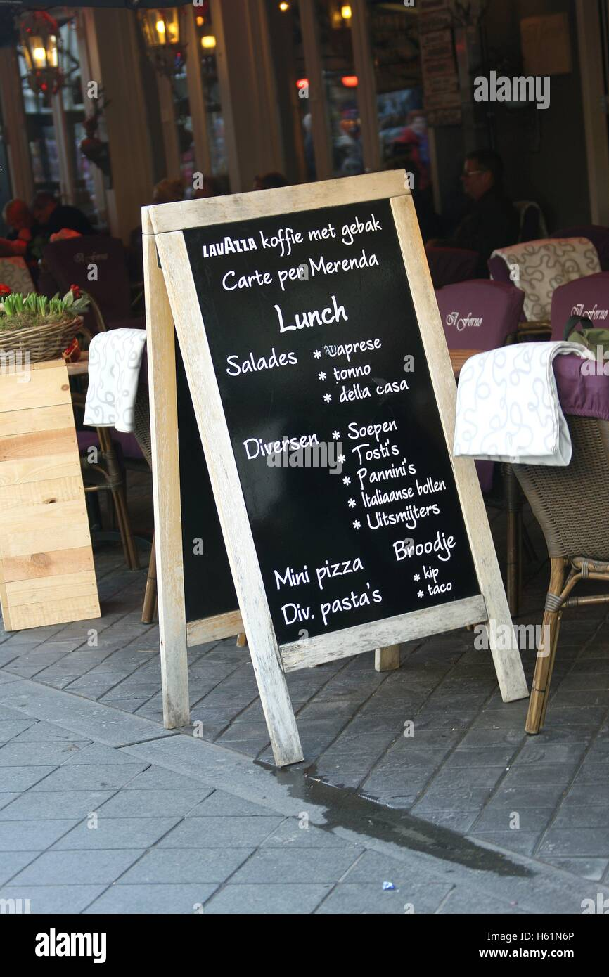 an advertisement chalkboard outside a cafe bar restaurant on stock