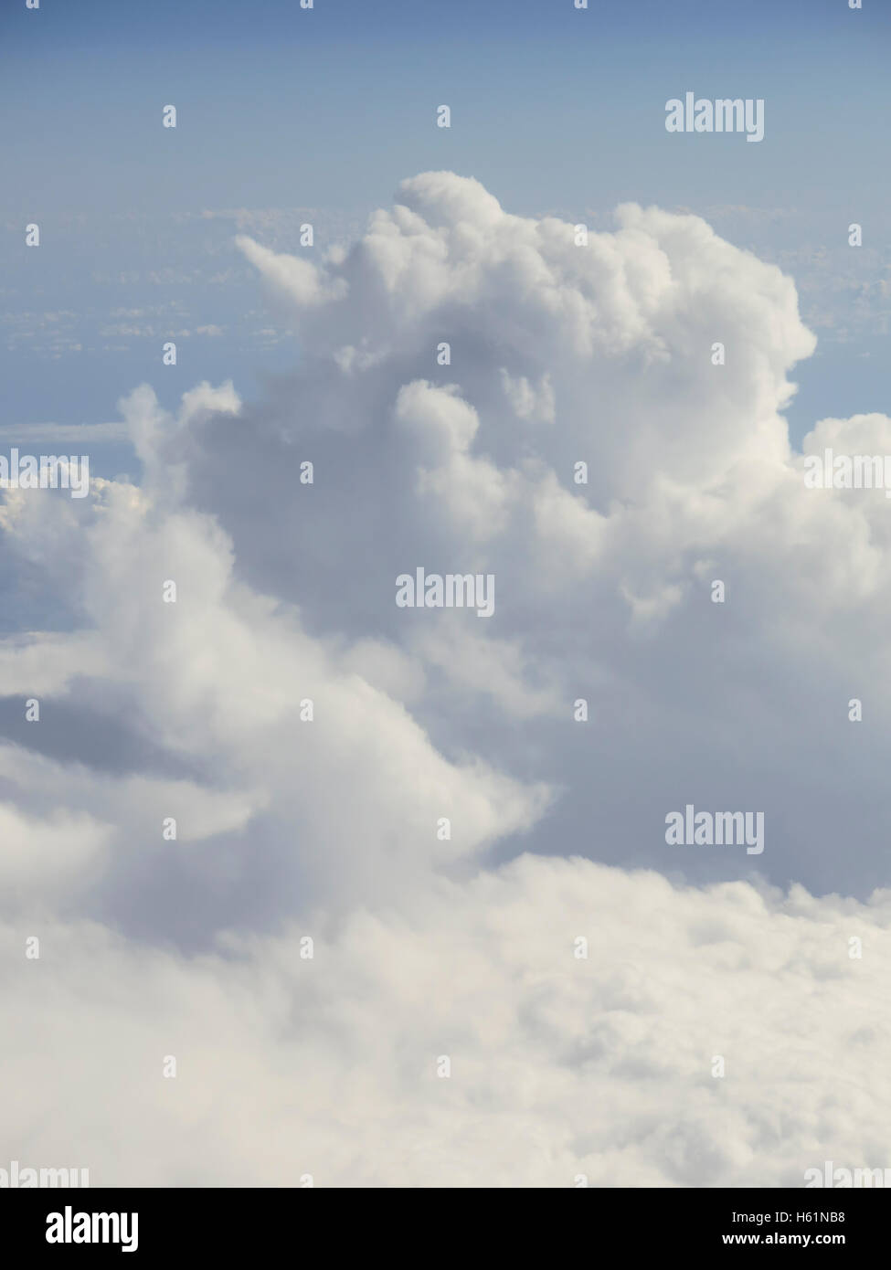 Beautiful cloudscape on a blue sky as seen from above - Stock Image