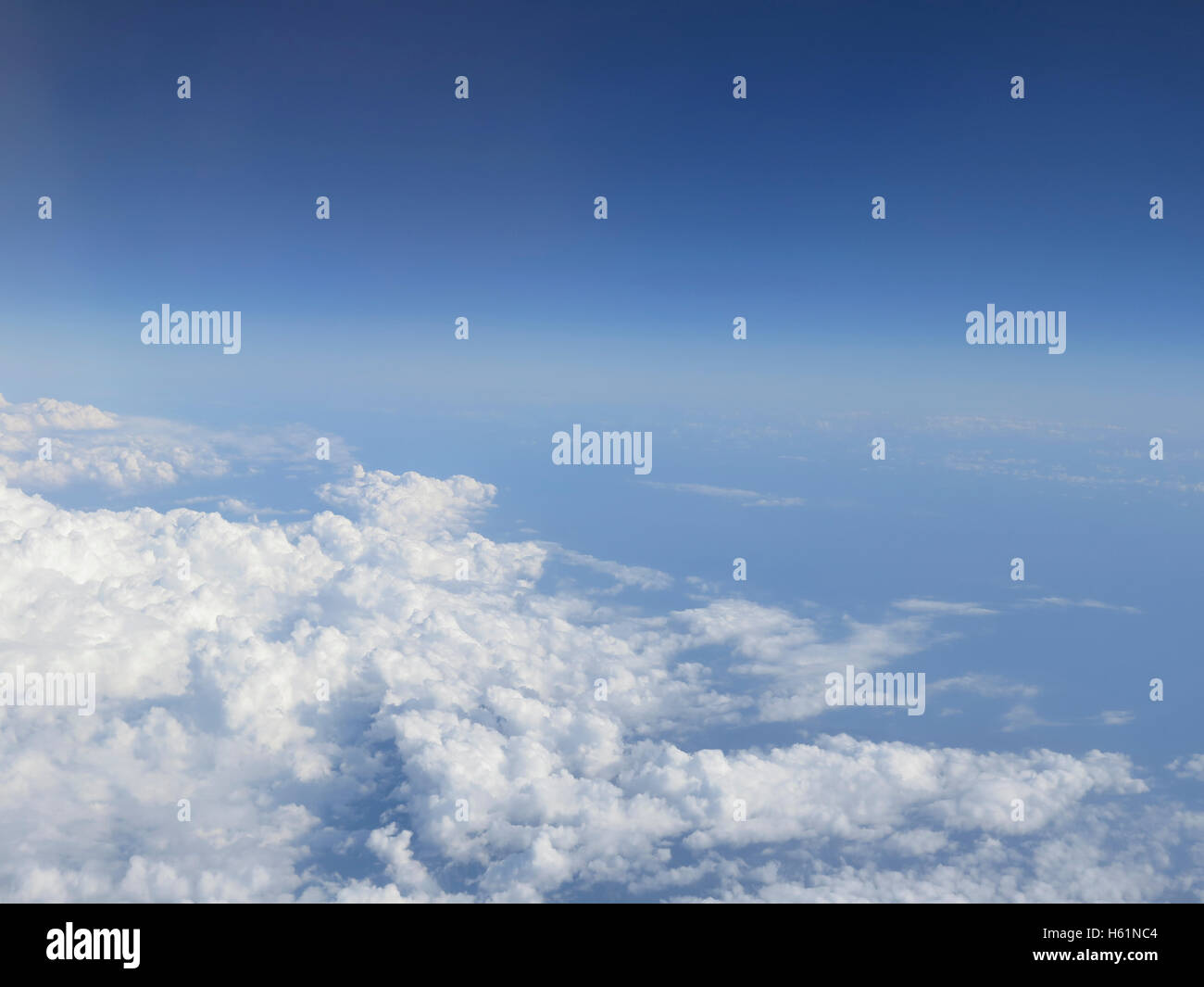 Beautiful cloudscape on a blue sky as seen from above Stock Photo