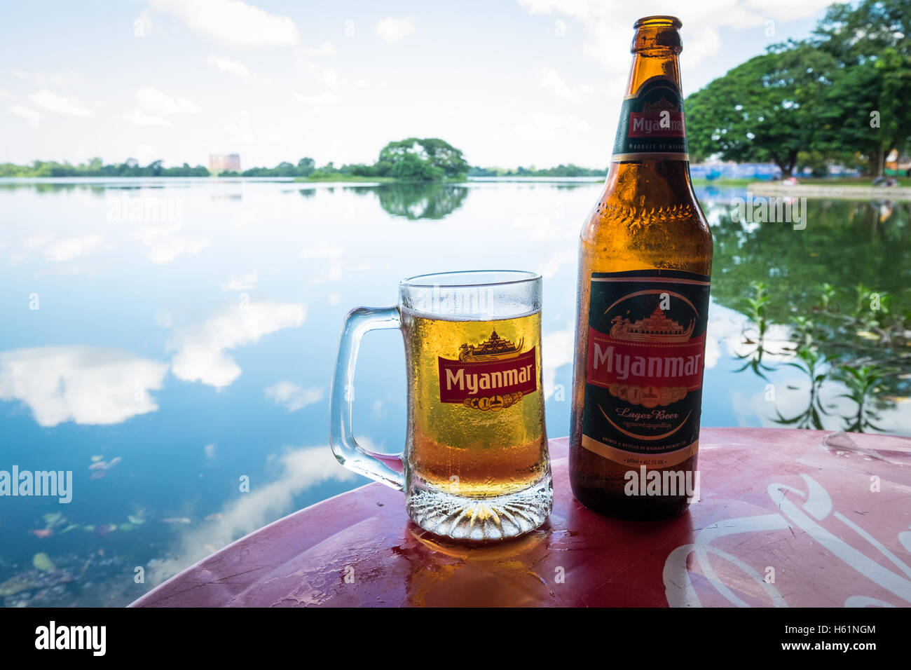 A glass and bottle of Myanmar beer at a bar on the banks of Inya Lake in Myanmar - Stock Image