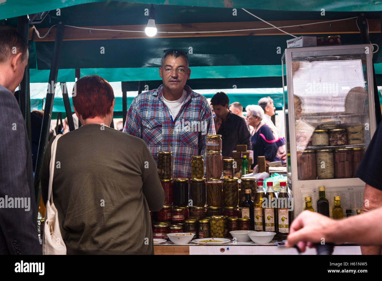 Stall with olive oil and olives, Producers' artisan market, Ban Jelacic Square, Zagreb, Croatia - Stock Image