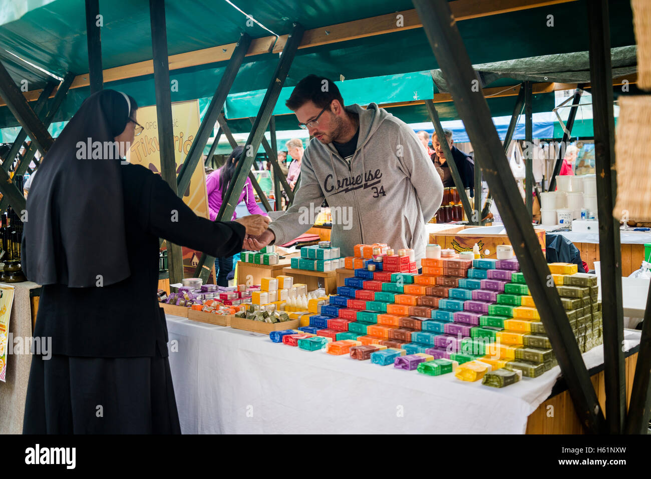 Nun buying handmade soap, Producers' artisan market, Ban Jelacic Square, Zagreb, Croatia - Stock Image