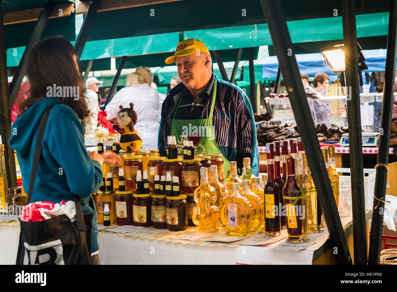 Stall with homemade honey, brandy and liqueur, Producers' artisan market, Ban Jelacic Square, Zagreb, Croatia - Stock Image