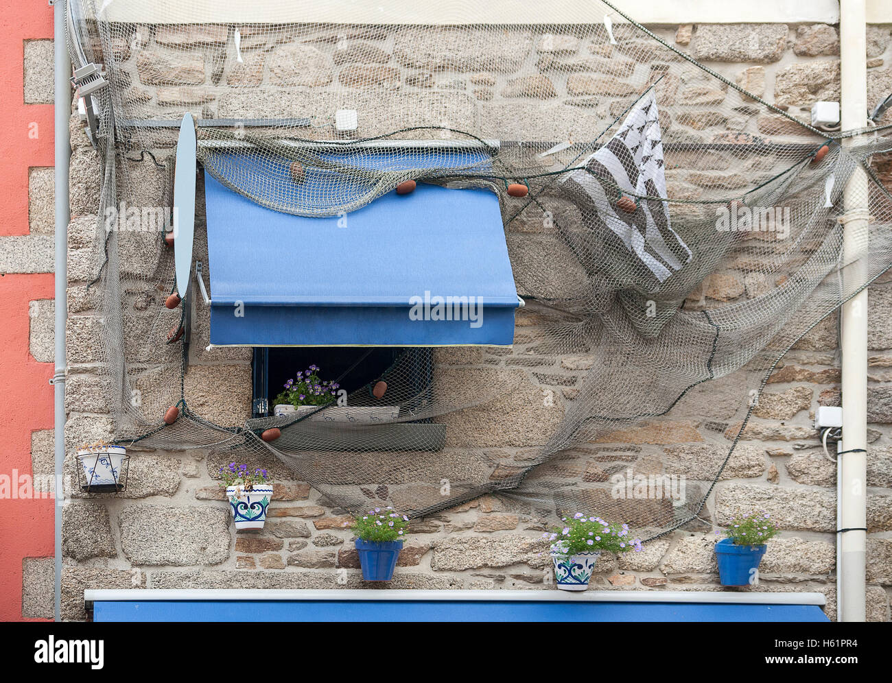 house facade in the old town of Concarneau in the Finistere department of Brittany in France - Stock Image