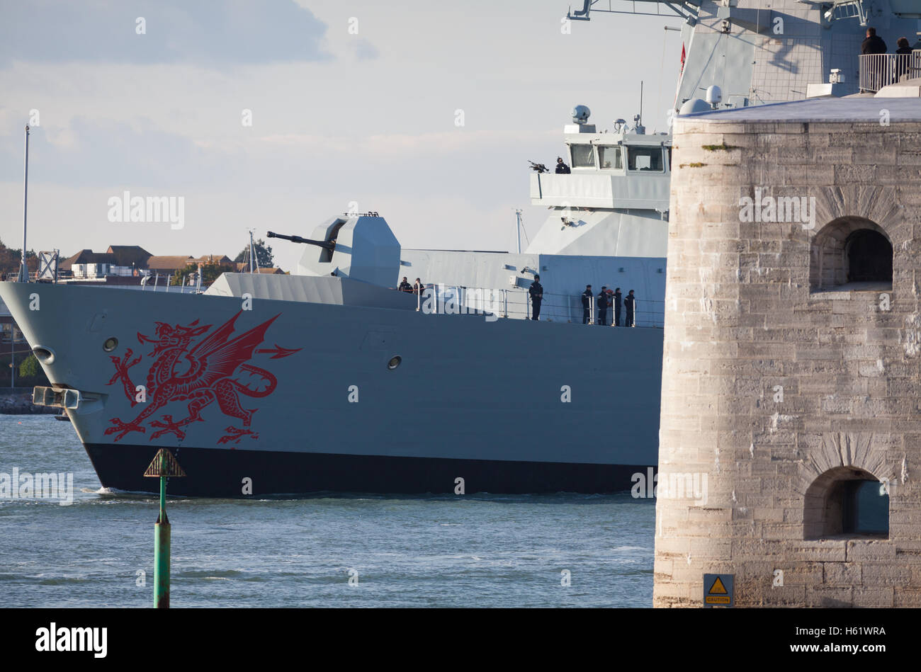 The Type 45 destroyer, HMS Dragon, leaving Portsmouth Harbour to intercept and escort two Russian corvettes sailing - Stock Image