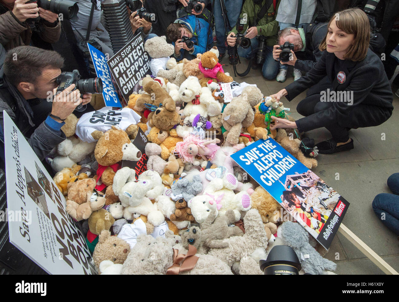 Downing Street/Whitehall.Actress Carey Mulligan places a teddy bear in Whitehall calling on the government to save - Stock Image