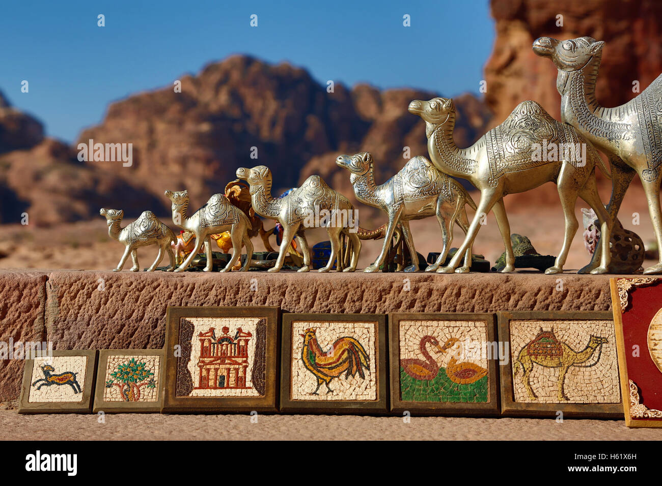 Camel souvenirs on sale at the Urn Tomb of the Royal Tombs in the rock city of Petra, Jordan - Stock Image
