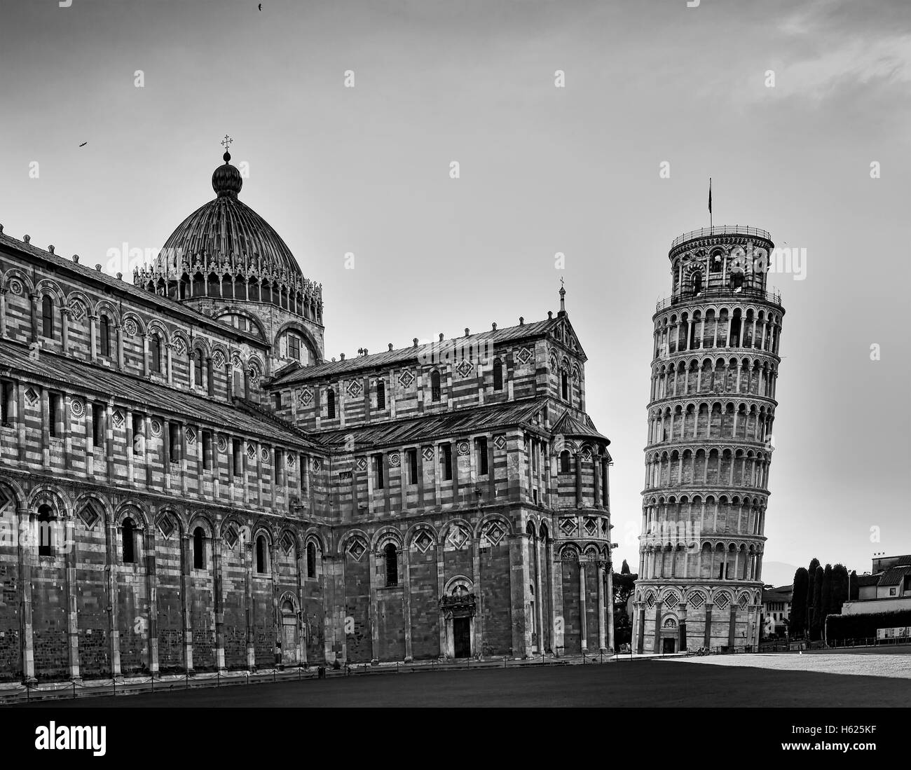 part of Duomo di Pisa and leaning tower if Pisa in black-white conversion at sunrise - great italian architectural - Stock Image