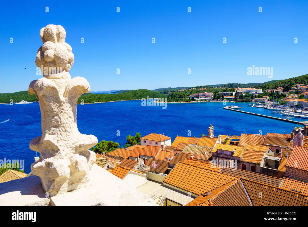 Rooftop view of the old town of Korcula, with roofs, houses and boats, in Dalmatia, Croatia Stock Photo
