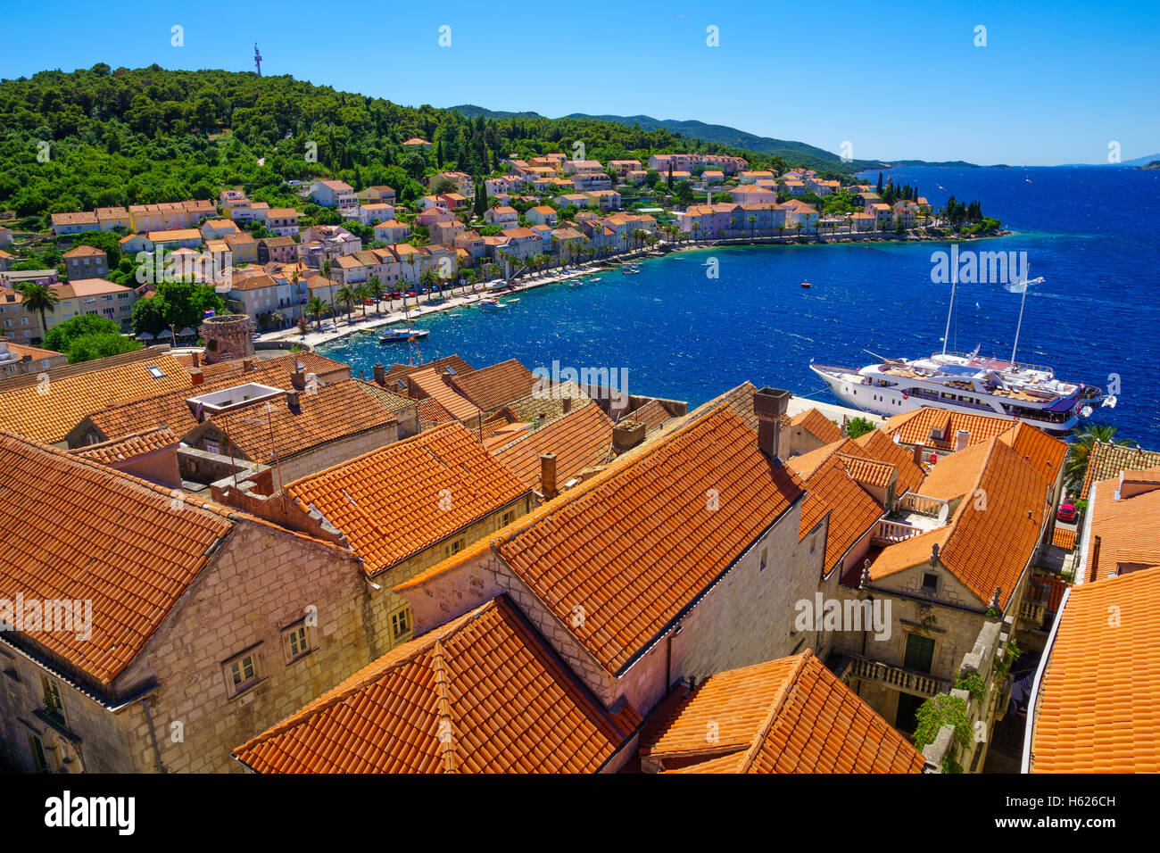 Rooftop view of the old town of Korcula, with roofs, houses and boats, in Dalmatia, Croatia - Stock Image
