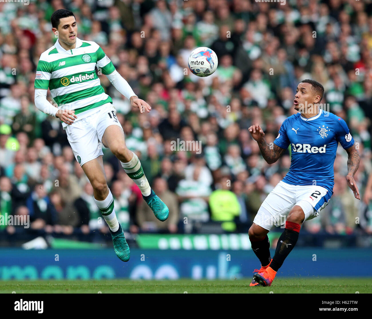 Celtic's Tom Rogic and Rangers' James Tavernier (right) battle for the abll during the Betfred Cup, Semi - Stock Image