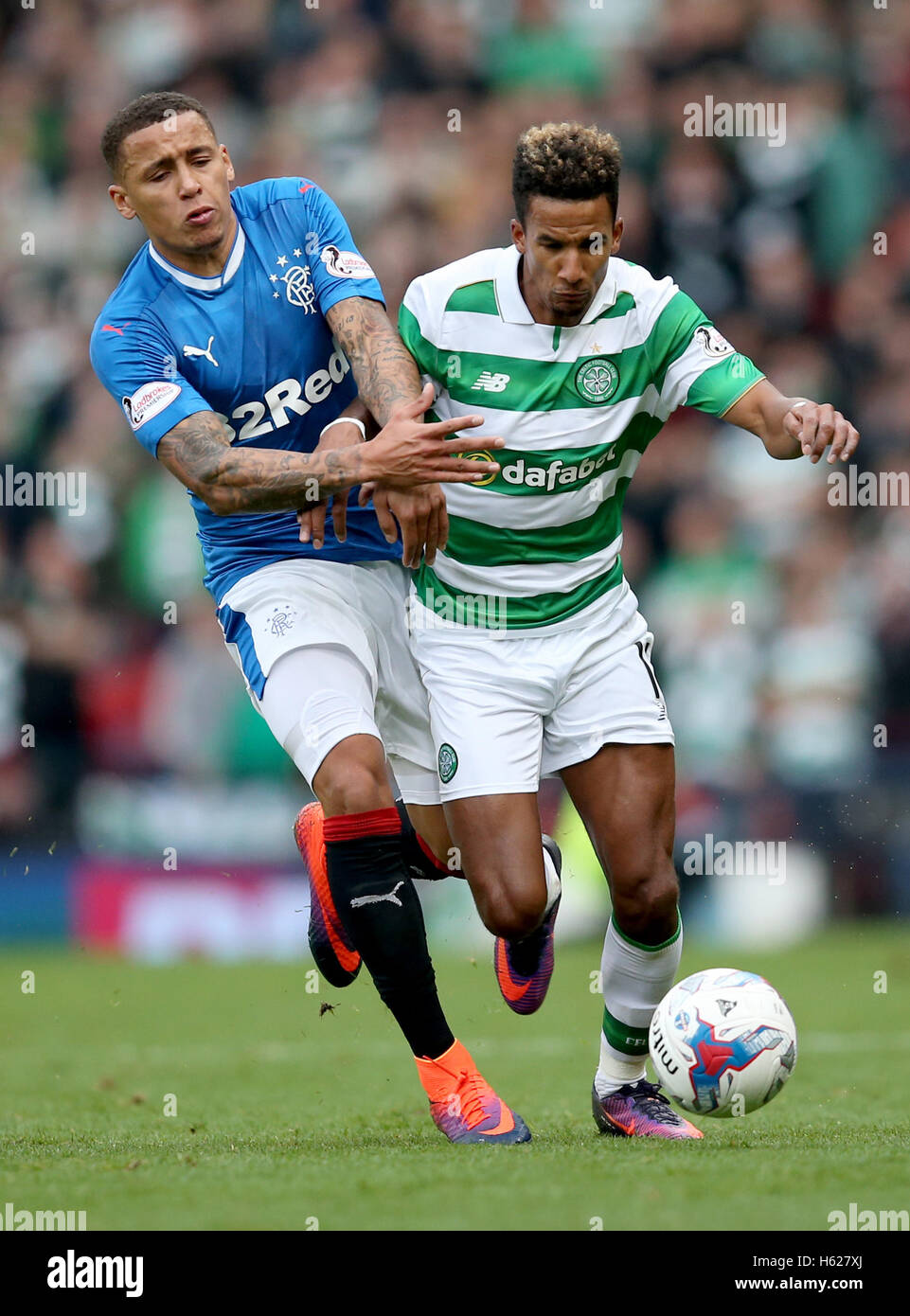 Rangers' James Tavernier and Celtic's Scott Sinclair (right) in action during the Betfred Cup, Semi Final - Stock Image