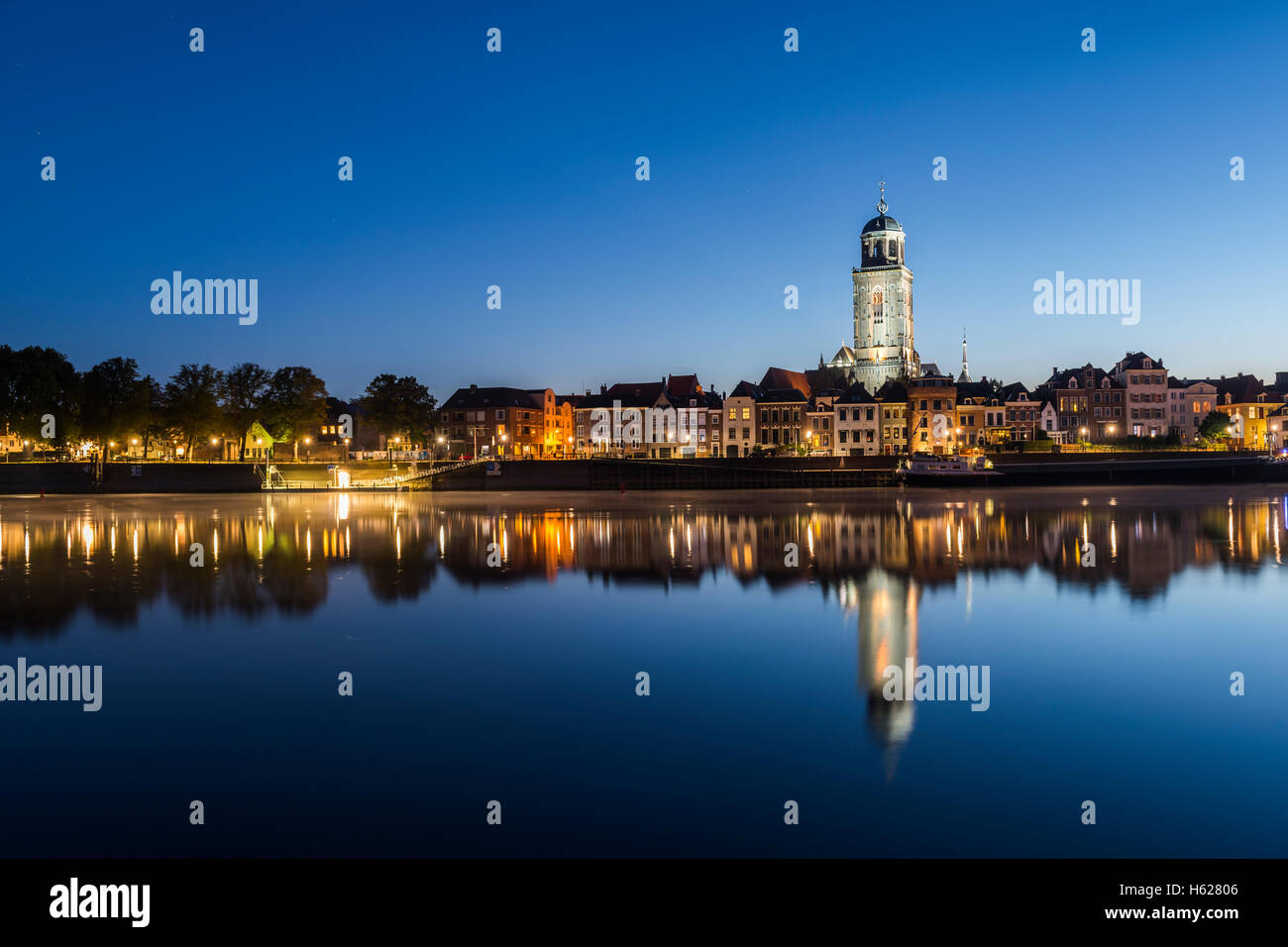 Deventer at the IJssel in the morning during blue hour with the Great Church or Lebuinuskerk in the province Overijssel. Stock Photo