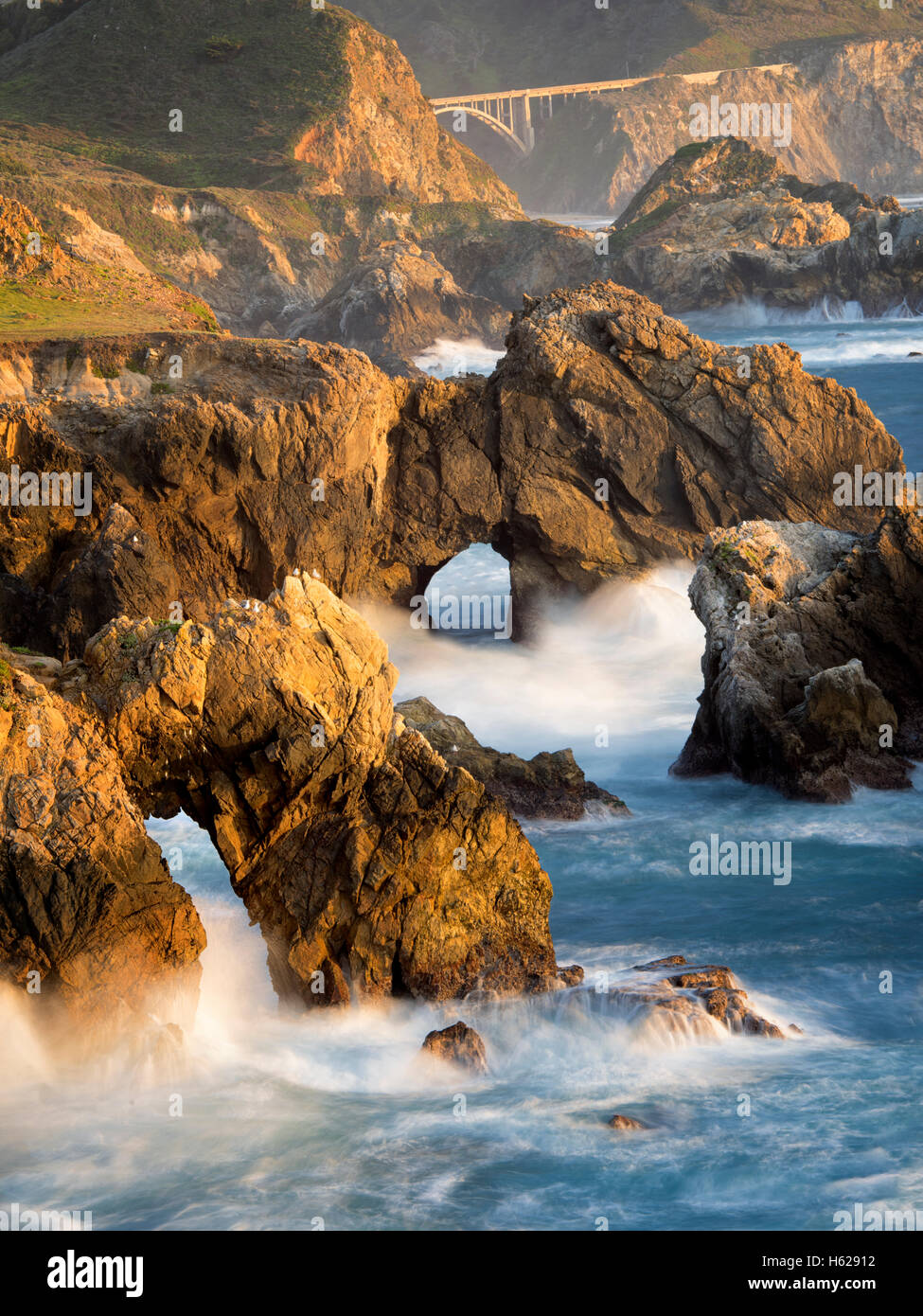 Arches and waves on Big Sur coast, California - Stock Image