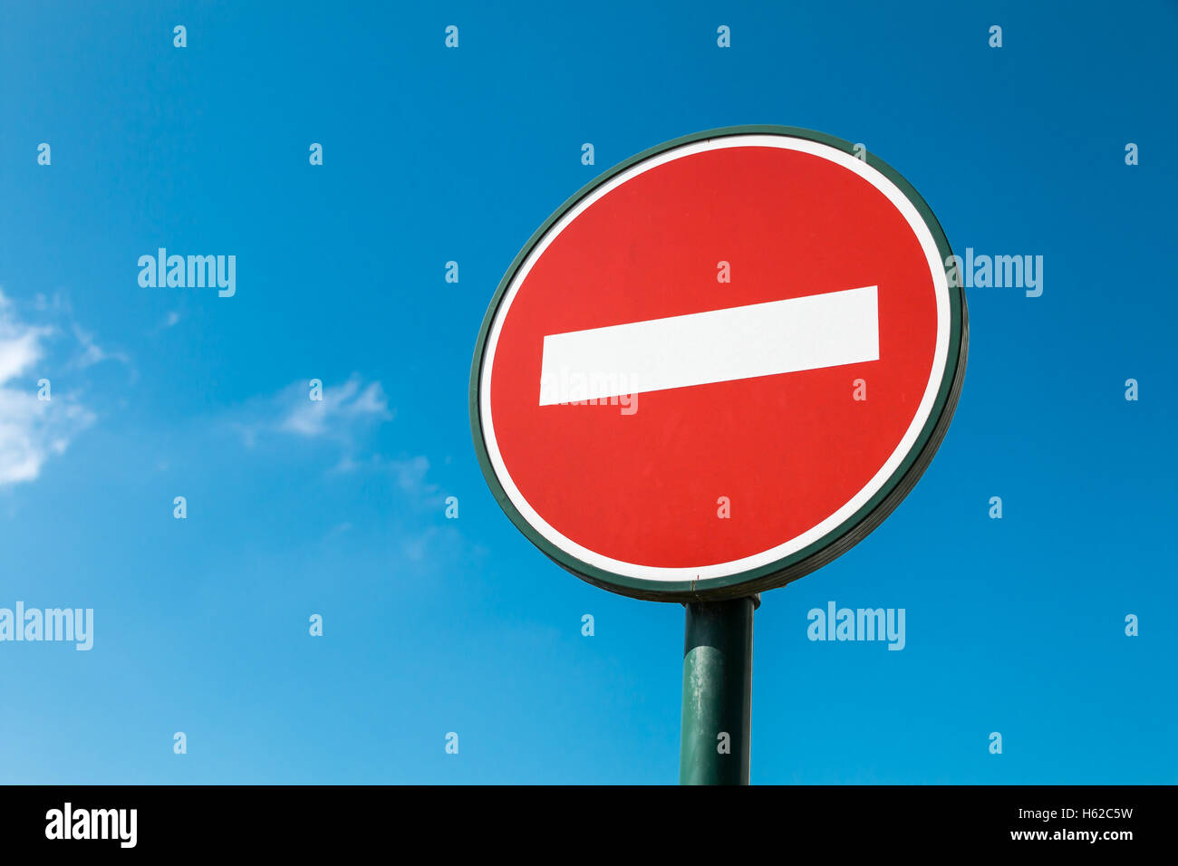 No entry sign in a a parking with blue sky - Stock Image