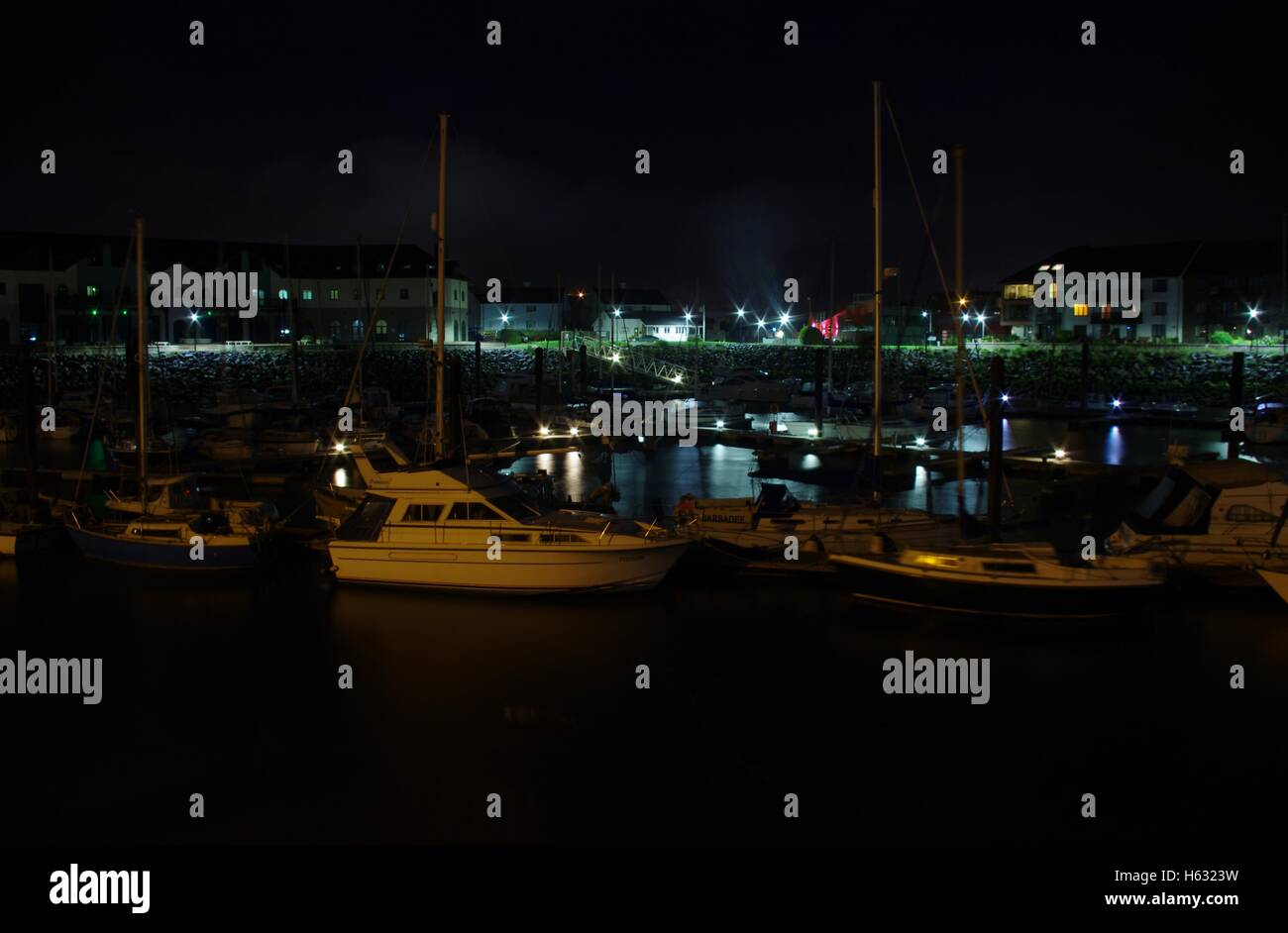 View overlooking Aberystwyth Harbour / Marina at night facing towards Y Lanfa, Trefechen, shot taken with long exposure. - Stock Image