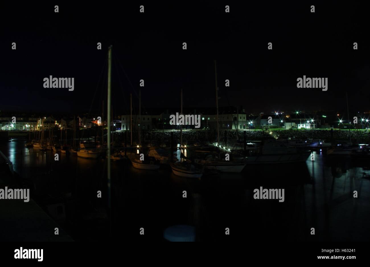 View overlooking Aberystwyth Harbour / Marina at night facing towards Y Lanfa, Trefechen, shot taken with long exposure. - Stock Image