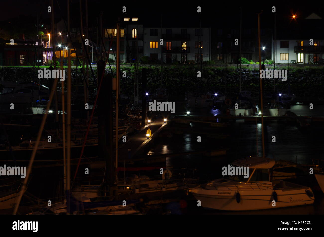 View overlooking Aberystwyth Harbour / Marina at night facing towards Y Lanfa Trefechen, shot taken with long exposure. - Stock Image