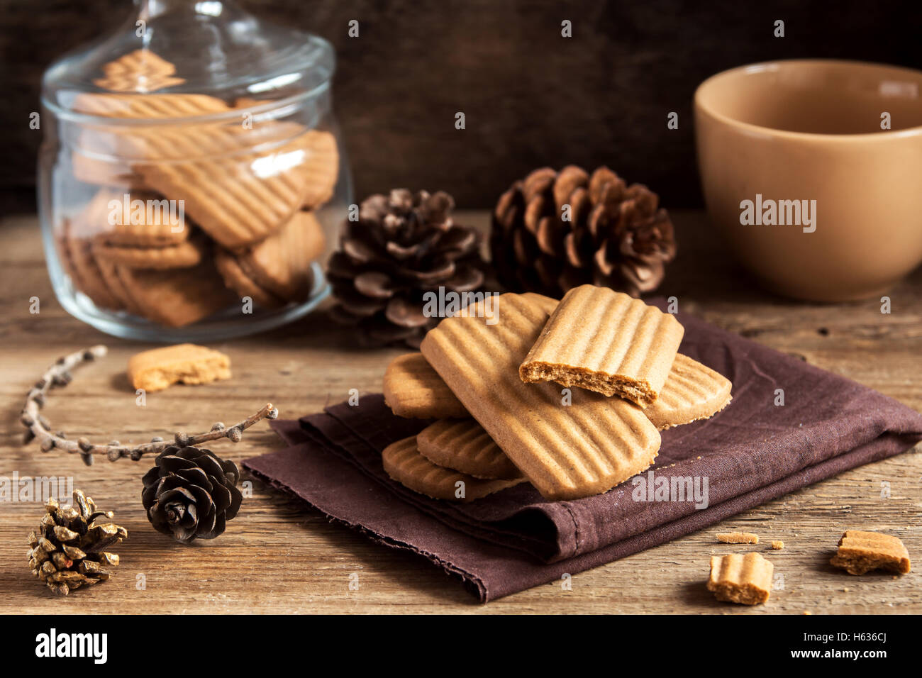 Homemade spicy ginger cookies on rustic wooden table close up, tasty winter ginger pastry - Stock Image
