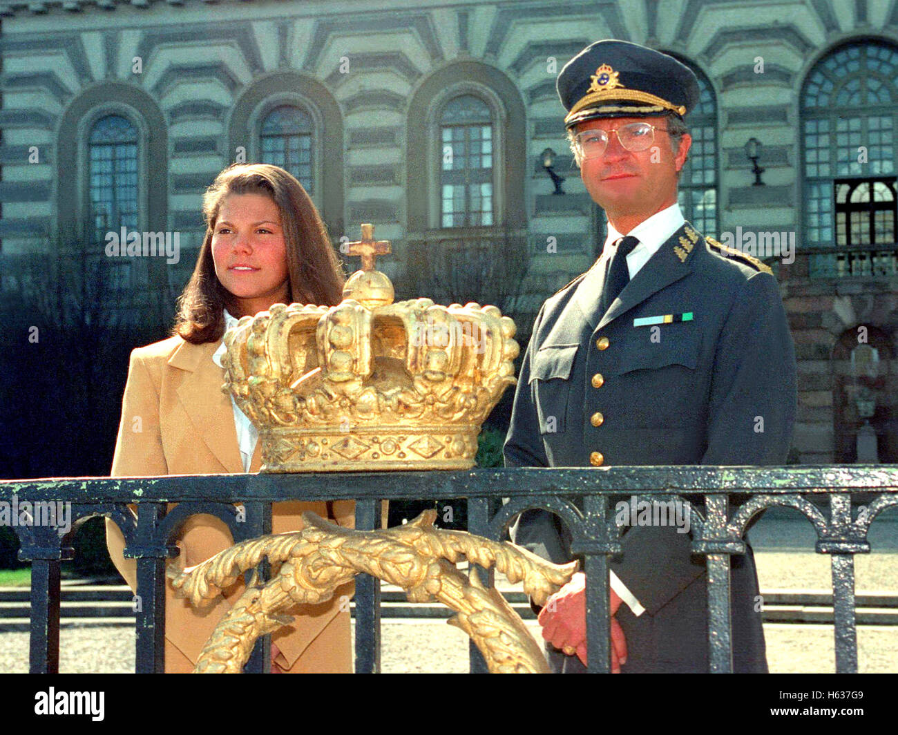 KING CARL XVI GUSTAV with his heir at Stockholm Castle  garden behind a gilded crown - Stock Image