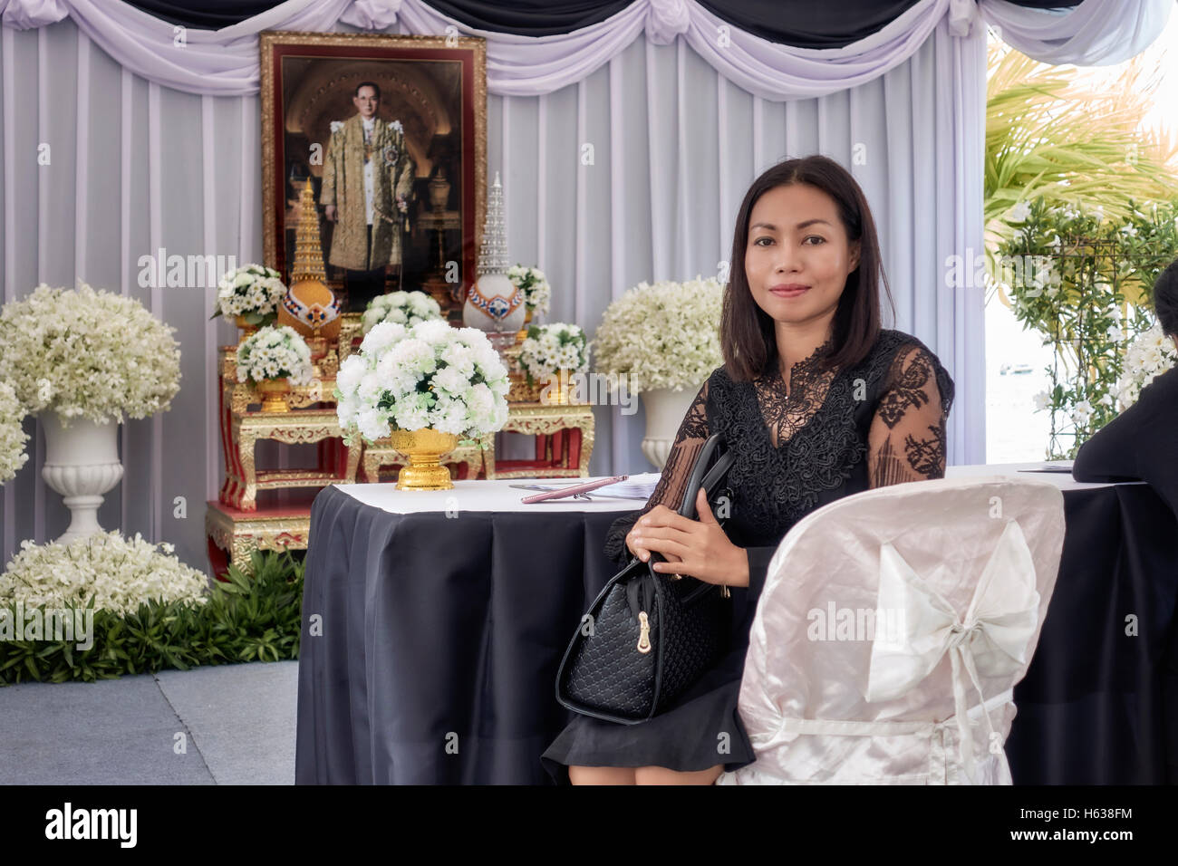 Thailand woman paying respect and mourning the death of King Bhumibol Adulyadej died 13th October 2016 - Stock Image