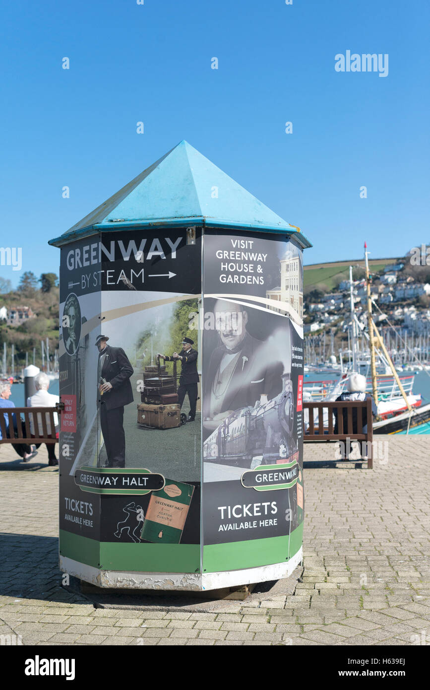 Colourful Kiosk advertising Agatha Christie's Greenway and Hercule Poirot on the Embankment at Dartmouth, Devon - Stock Image