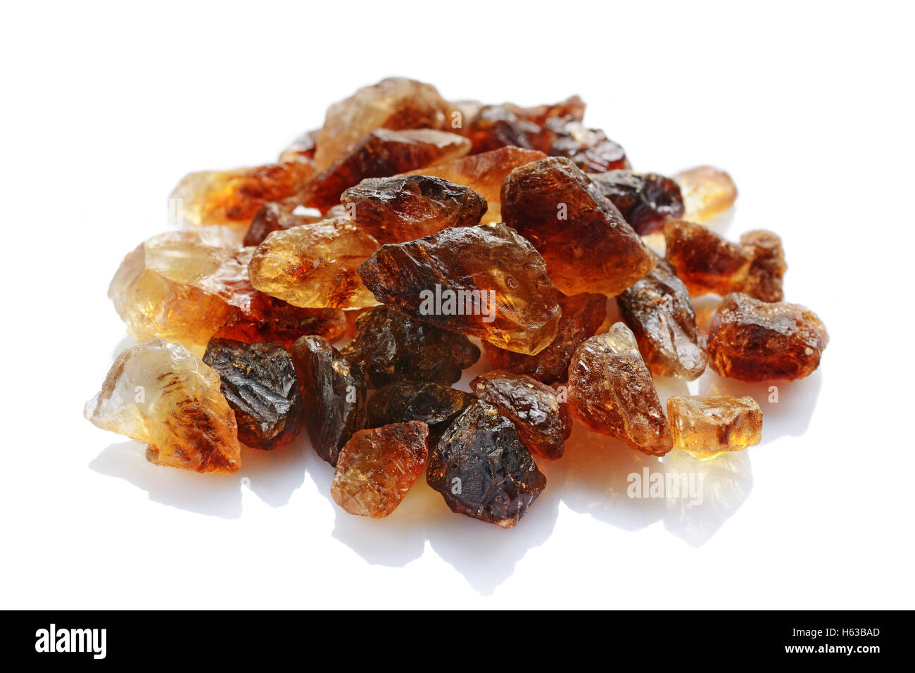 Caramelized sugar closeup isolated on white background - Stock Image