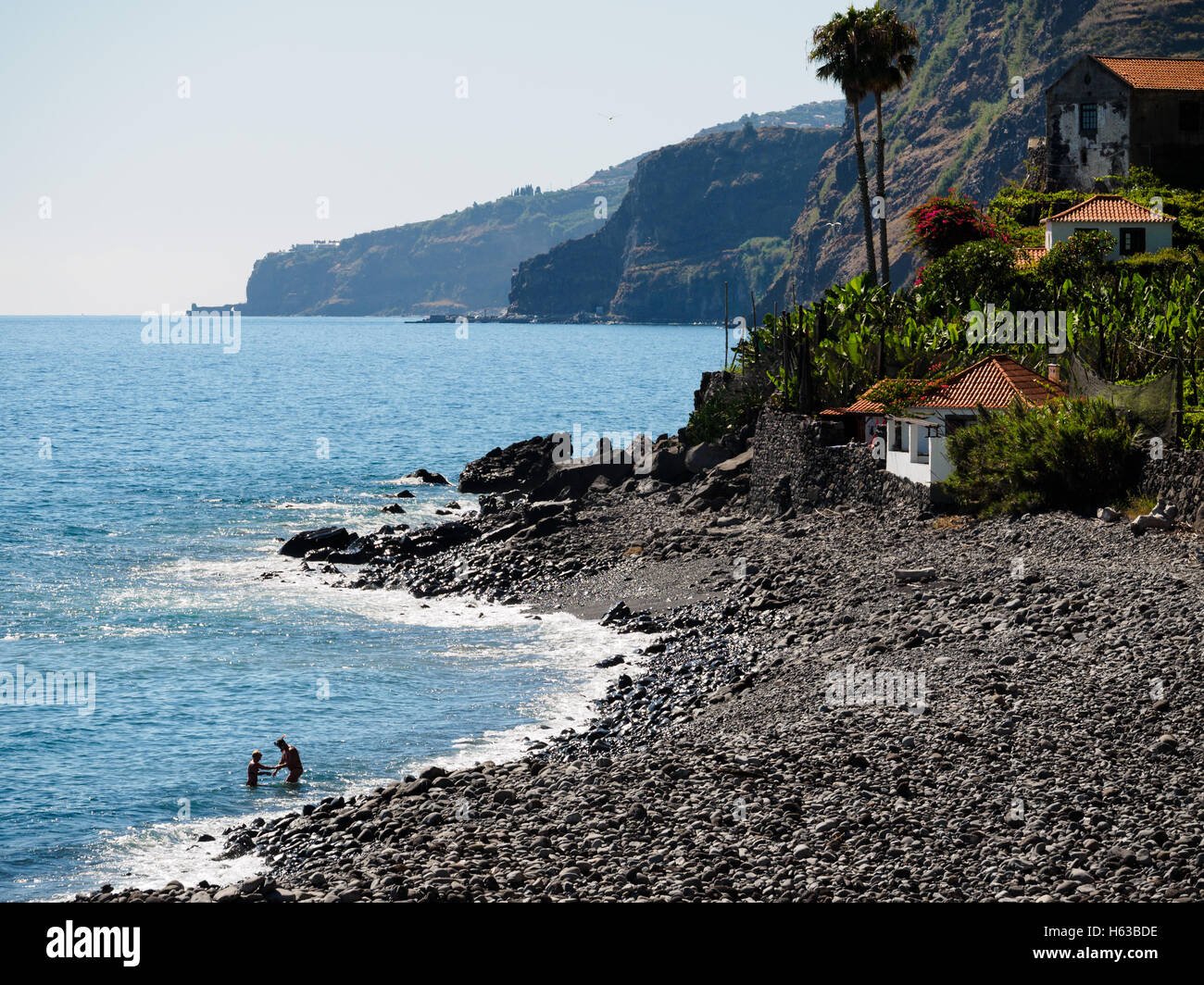 The pebble beach of Faja dos Padres on the Portuguese island of Madeira - Stock Image