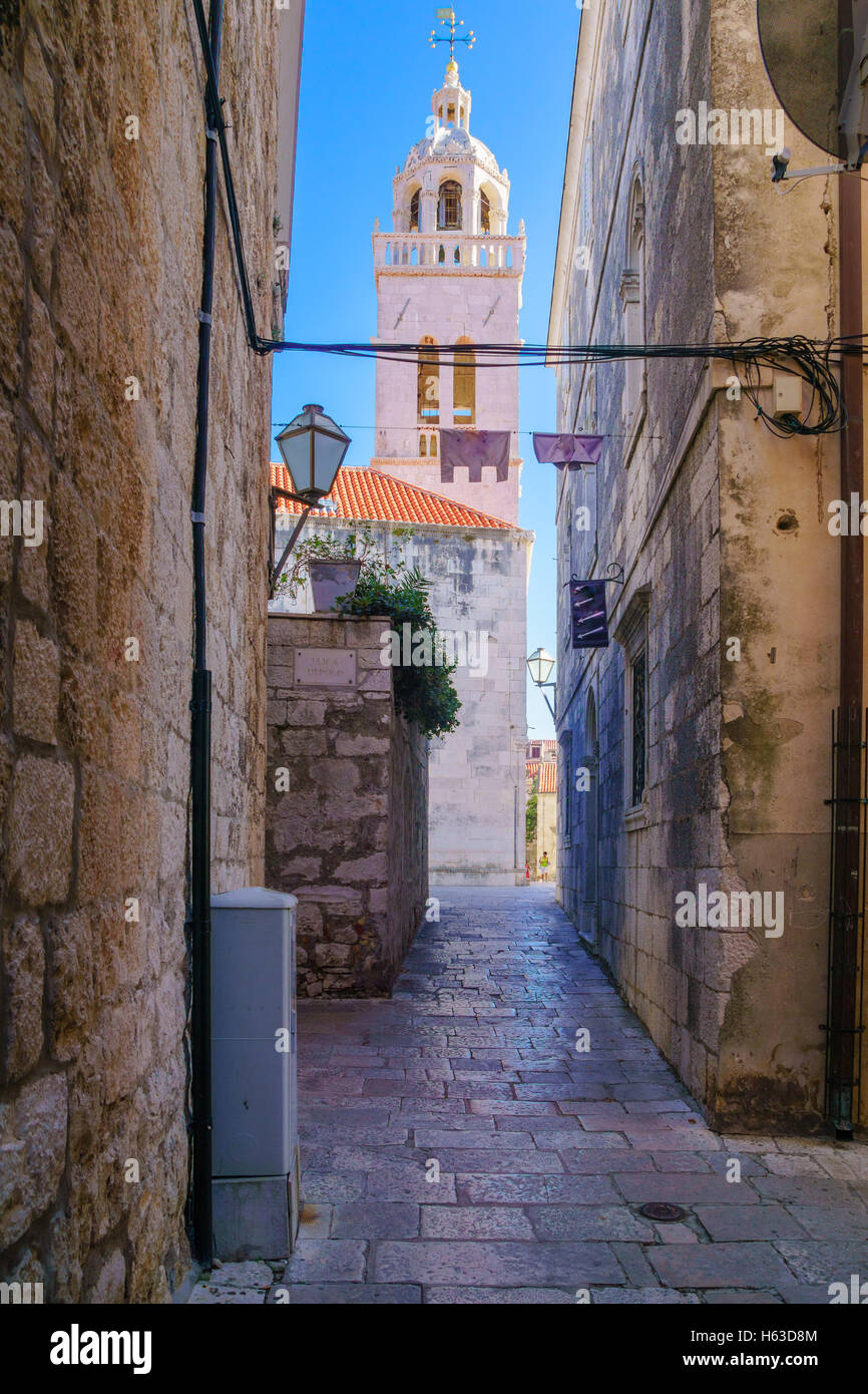 Cathedral tower and an alley in the old city of Korcula, in Dalmatia, Croatia - Stock Image