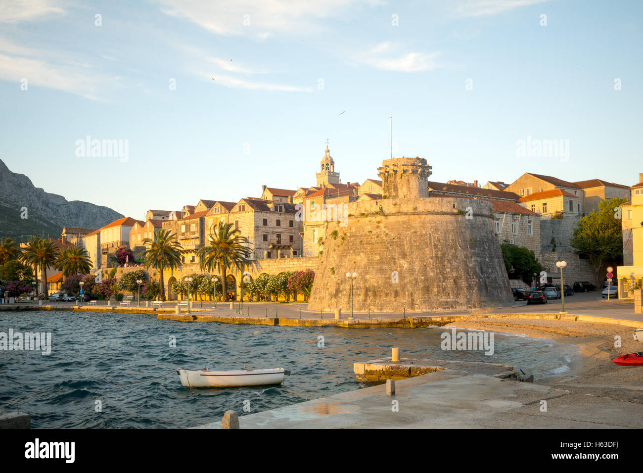 Sunset scene in the old town (west side), with the walls, houses, boats, in Korcula, Croatia - Stock Image