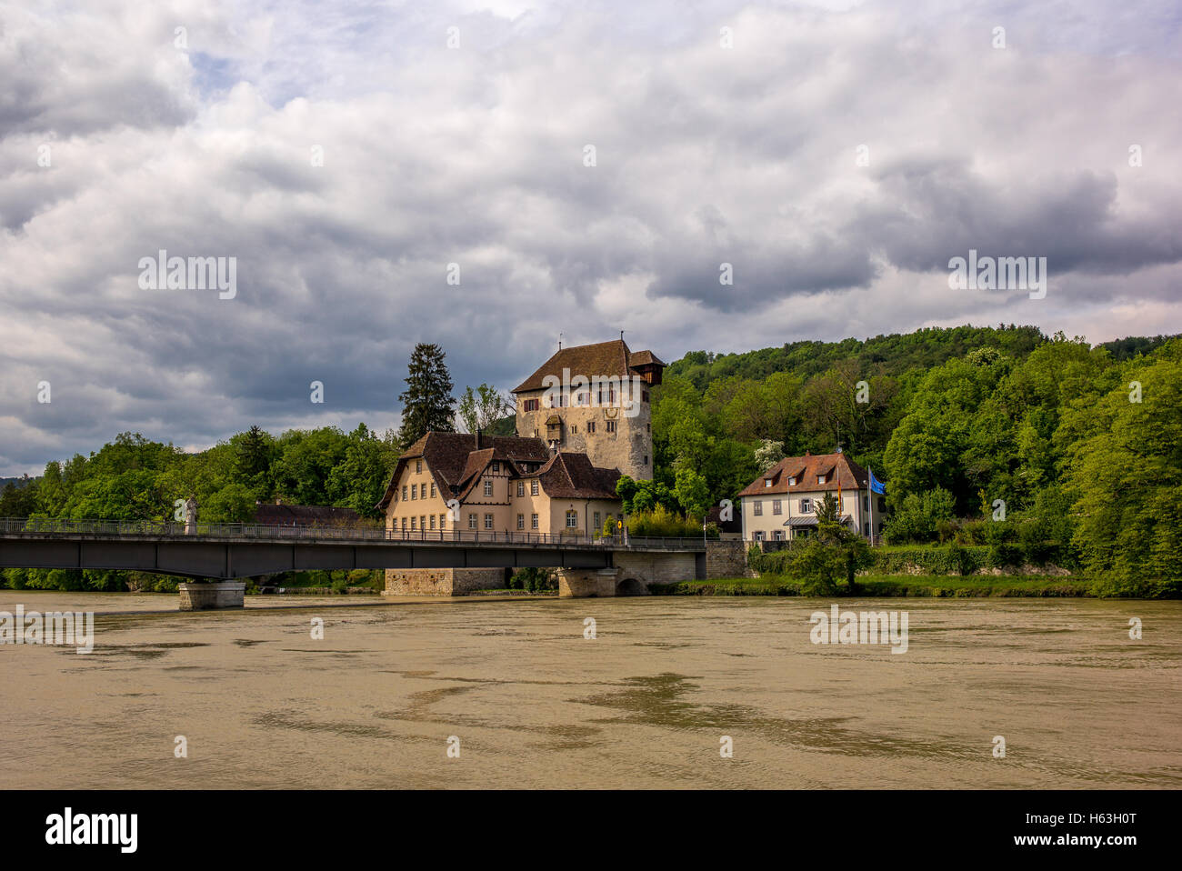 View of the bridge and castle in Kaiserstuhl of Switzerland with the Rhine river in flood - Stock Image