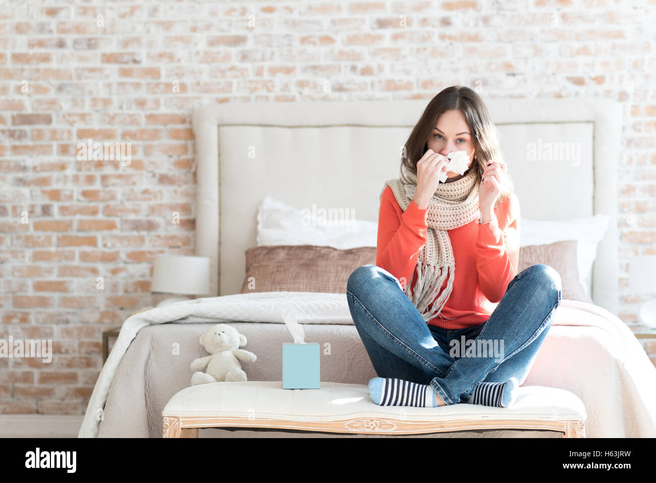 Pleasant gloomy woman suffering from cold - Stock Image