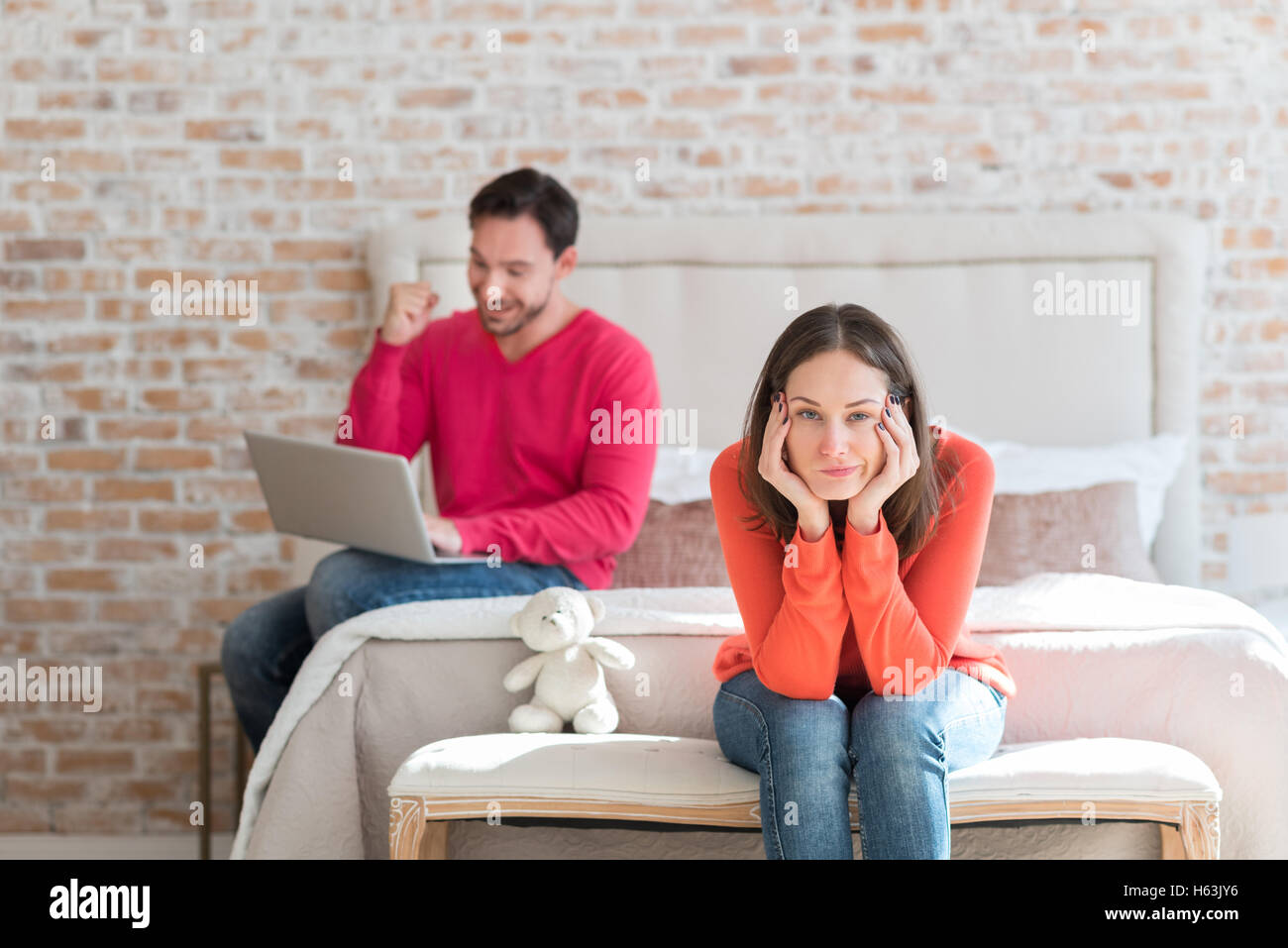 Dissatisfied unhappy woman sitting in the bedroom - Stock Image