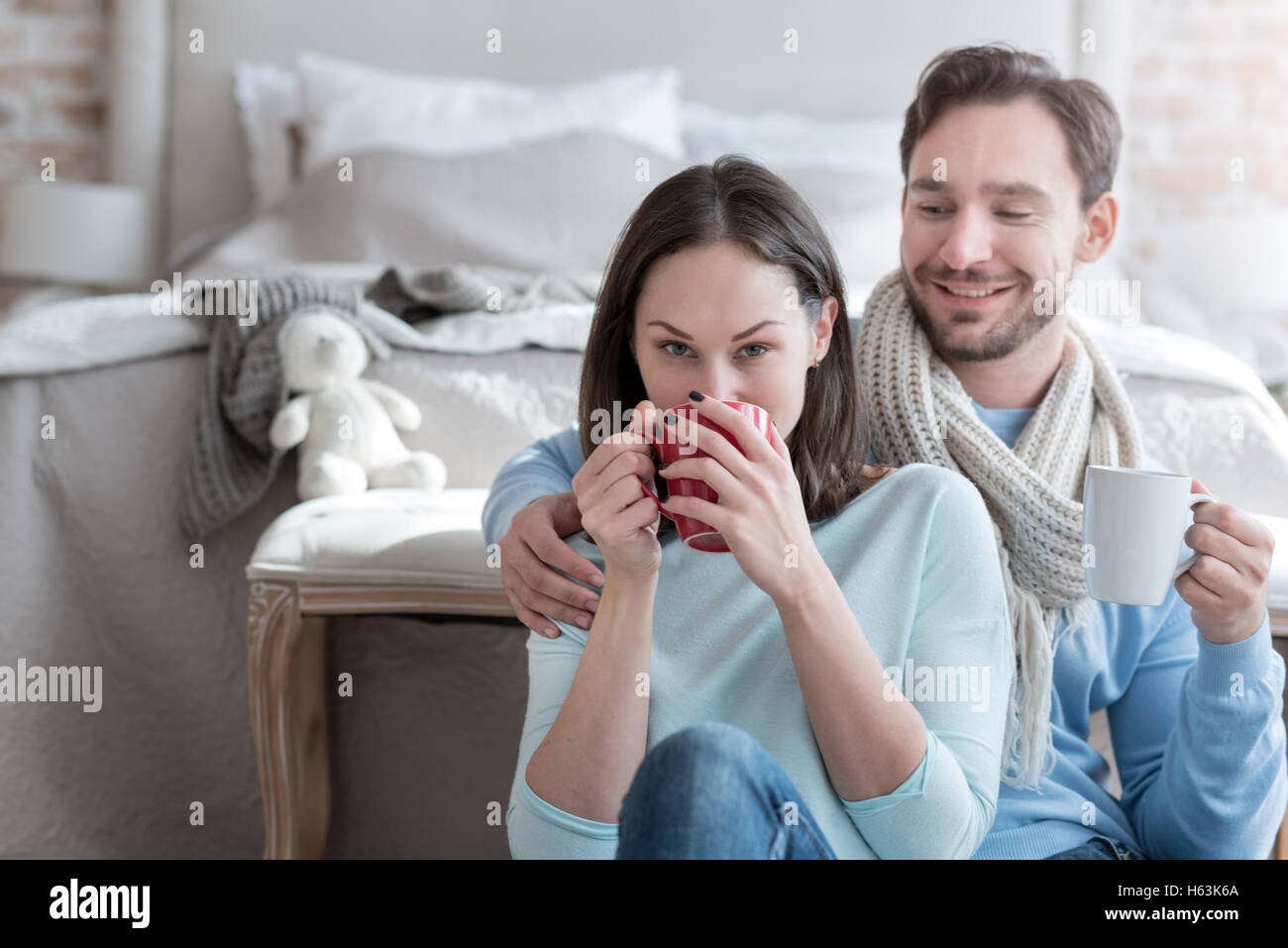 Good looking nice woman taking a sip of tea - Stock Image