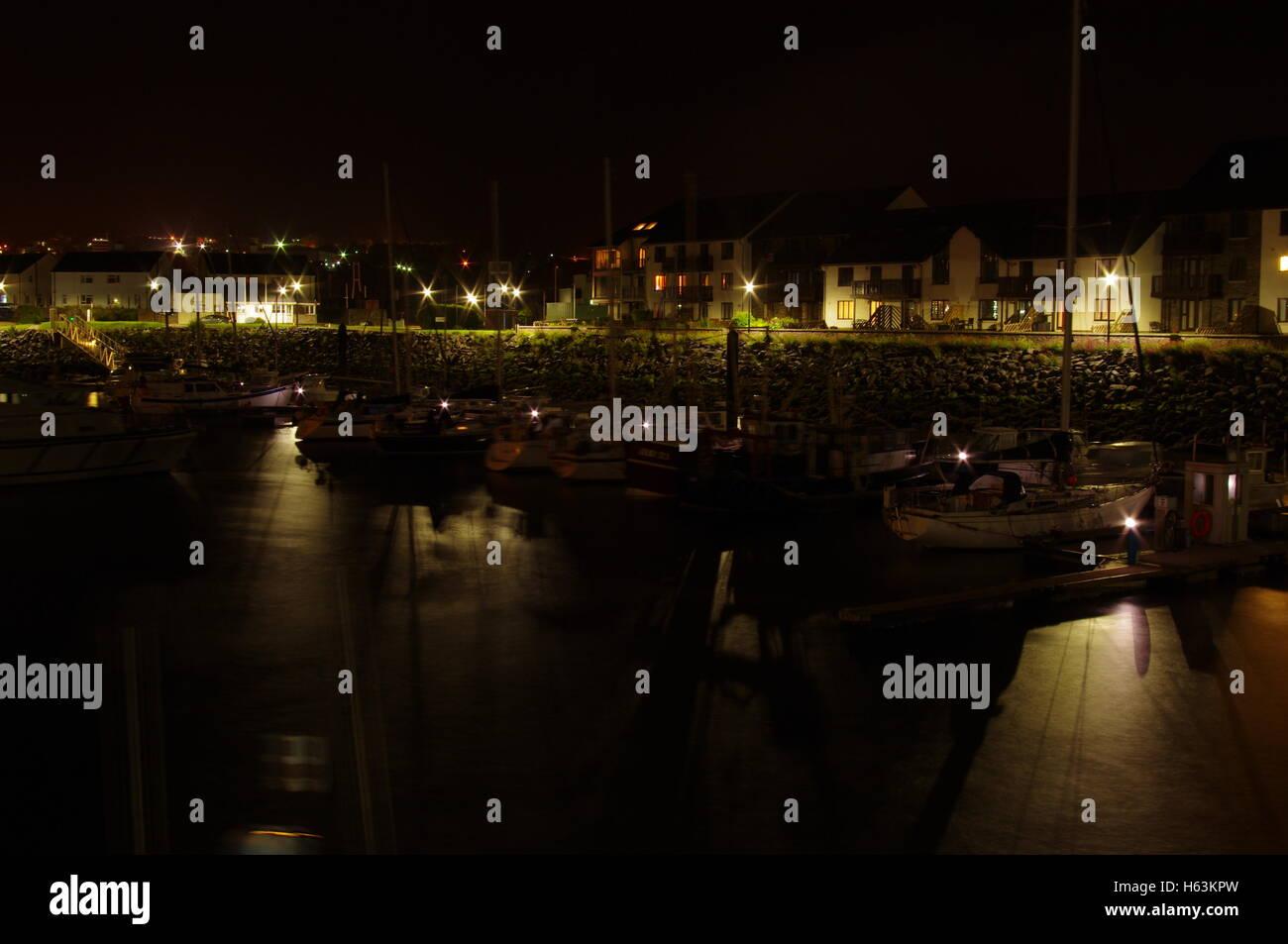 View overlooking Aberystwyth Harbour / Marina at night facing towards Y Lanfa Trefechen, shot taken with long exposure. - Stock Image