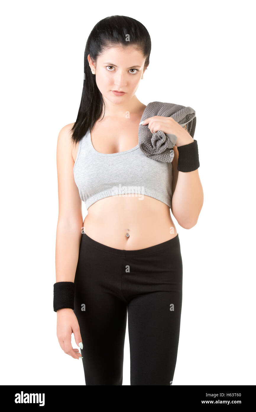 Woman resting with a towel around her neck after a fitness workout, isolated in white - Stock Image