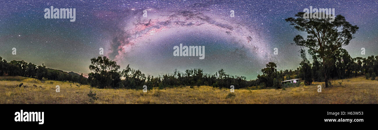 A 360° nightscape panorama of the Milky Way from Carina (at right) to Scutum (at left) arching over the paddock - Stock Image